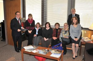 Pictured (L-R): Assemblyman Thomas Abinanti, 37th District, and Chair of the NYS Assembly Libraries & Education Technology Committee; Maureen Petry, Director, The Warner Library/Tarrytown; Pamela Bernstein, Librarian, and Carolyn Gallagher, Head of Children's Services, Irvington Public Library; Patricia Fontanella, Trustee, Westchester Library System & Library Trustees Association of New York State; Elise Burke, Executive Assistant, Westchester Library System; joined by Ric Swierat, Trustee, Mid-Hudson Library System (standing) and Joanne Sold, Chief of Staff for Assemblyman Thomas Abinanti